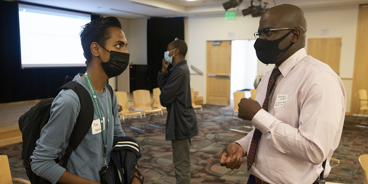 Student Alex Nandalall speaks with University Police Deputy Chief of Police Quanison Wright at the New Student of Color Network event hosted by the Multicultural Resource Center in the Chenango Champlain Collegiate Center, Sept. 9.
