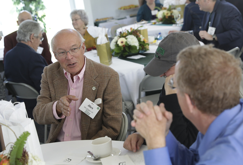 Alex Huppé '69 speaks with his fellow alumni at Harpur College's 70th birthday kickoff. He is the son of founding faculty member Bernard Huppé.
