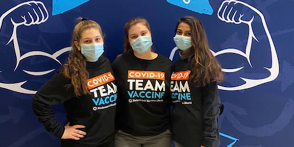 Left to right: Diana Kwiatkowski, Marisa Ferber and Laraib Khan are among several Binghamton University pharmacy students who volunteered to administer the COVID-19 vaccine at MetLife Stadium.