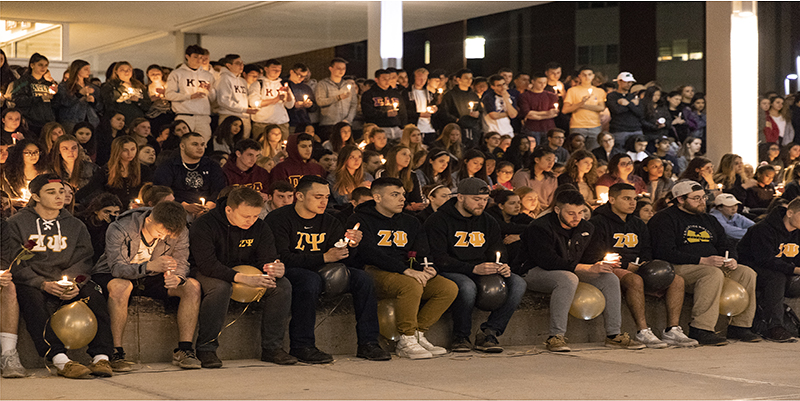 Members of the Zeta Psi fraternity are joined by hundreds of others to celebrate the life of 19-year-old Joao Souza.
