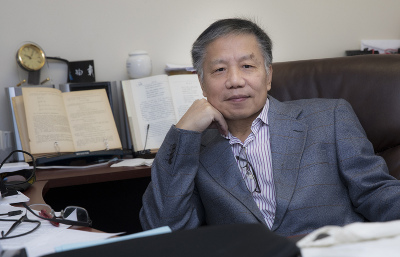 Zili Yang, an economics professor at Binghamton University, is seen in his office in the Library Tower.