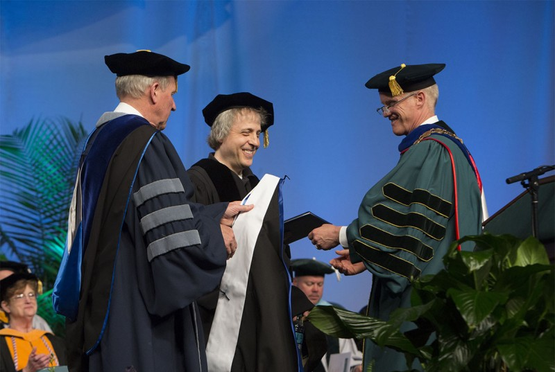 President Harvey Stenger and Provost Donald Nieman prepare to hood Marc Lawrence '81 at the 2016 Graduate School Commencement. Four will be so honored at this year's Graduate School ceremony, Friday, May 19.
