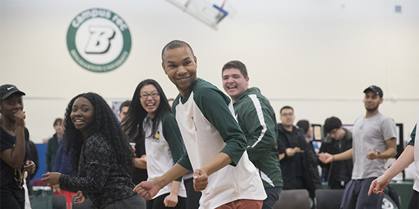Students participate in a Zumba class during Binghamton University's annual Health Fair.