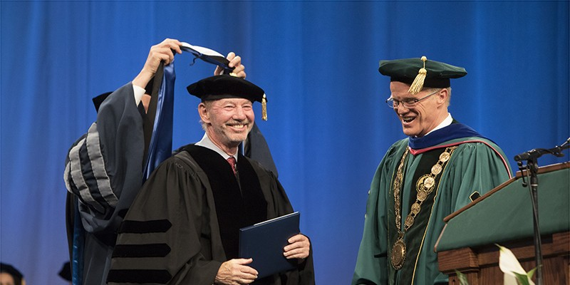 Three alumni will receive honorary degrees at the 2018 Graduate School Commencement ceremony at 4 p.m. Friday, May 18, in the Events Center. Here, Tony Kornheiser '70, is shown receiving his honorary degree in 2017.