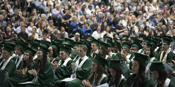 Students applaud during a 2017 Harpur College of Arts and Sciences Commencement ceremony.
