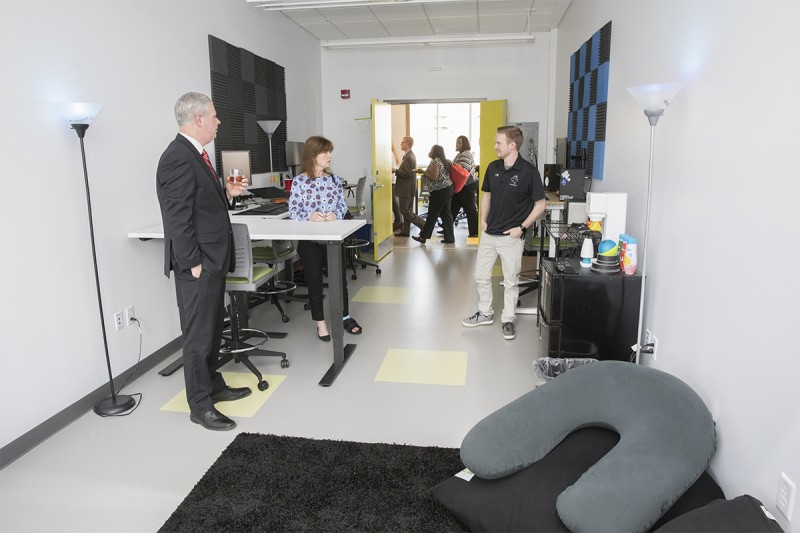 Broome County Executive Jason Garnar and Colleen Wagner speak with Trevor Barney of the startup company SouthSixty at the space Barney's company is leasing at the Koffman Southern Tier Incubator.