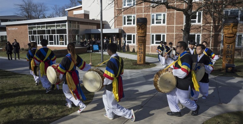 Members of Sul Poong, a student organization that performs Korean traditional percussion, entertains outside of Old Champlain to kick off the dedication of the Young Sam Kim Korean Student Center.