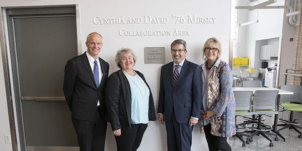 Cynthia and David '76 Mirsky Collaboration Area dedication at The Koffman Southern Tier Incubator in downtown Binghamton, April 8, 2019, with President Harvey Stenger, Betsy Koffman and the Mirskys posing in front of the new sign.