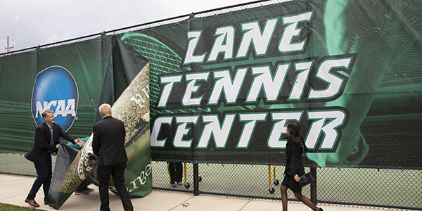 Michael F. Lane '89, President Harvey Stenger and Lisa Marie Lane '89, MA '92 reveal the Lane Tennis Center signage at the dedication of the complex April 26, 2019.