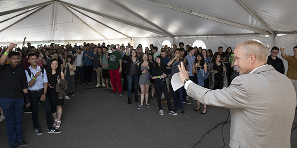 President Harvey Stenger toasts graduating seniors who came out in force for the 2019 Champagne Senior Send-off.