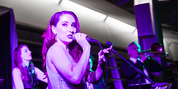The June 1 Binghamton University Forum Black-Tie Gala featured vocalist Robyn Adele Anderson '11, a cast member and featured artist for Postmodern Jukebox, whose videos have over 200 million YouTube views. The gala was held at the Appalachian Collegiate Center on campus.