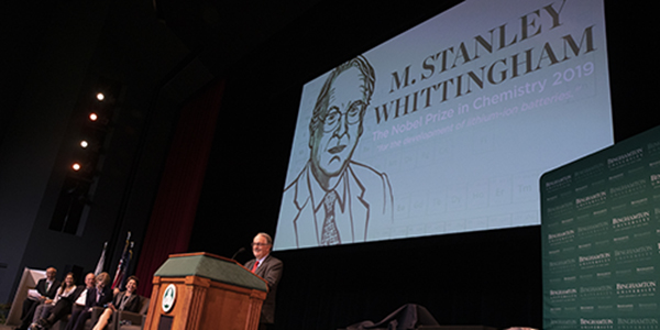 Distinguished Professor and Nobel Laureate M. Stanley Whittingham at the podium on the Osterhout Concert Theater stage.