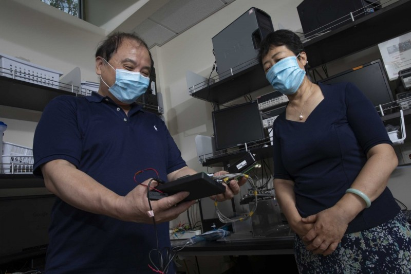 Susan Lu, professor of systems science and industrial engineering and Chuan-Jian Zhong, professor of chemistry, photographed at Zhong's laboratory in the Smart Energy Building at the Innovative Technologies Complex.