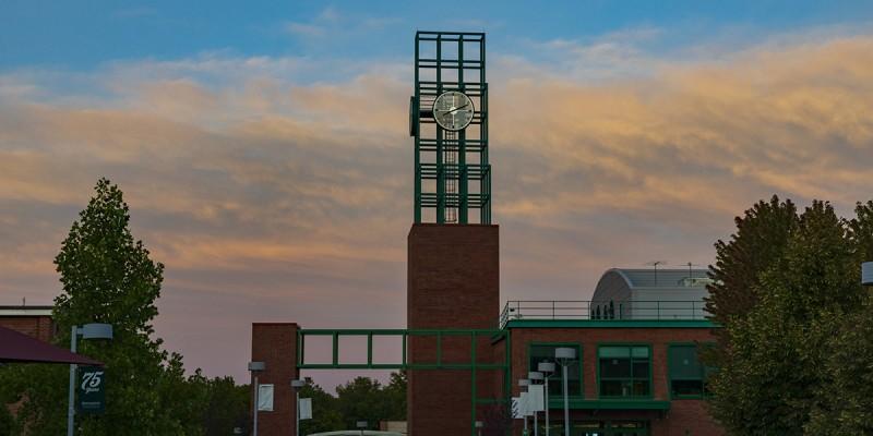Binghamton University's clock tower atop the University Union, at sunset.