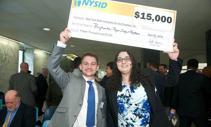 Two students who worked on the project, Jack Lucas and Natalie Zanco, accepting the grand prize.