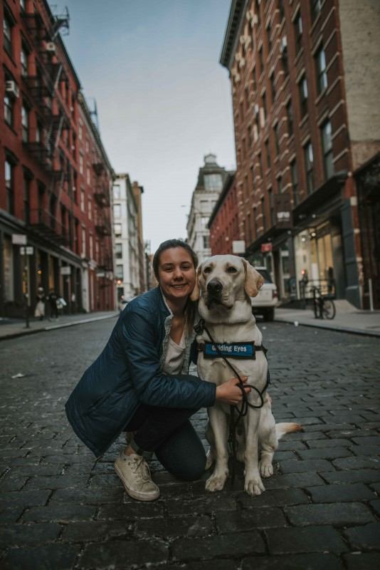 Biological sciences major Yfke Havinga and Stan, a guide dog in training, in New York City.