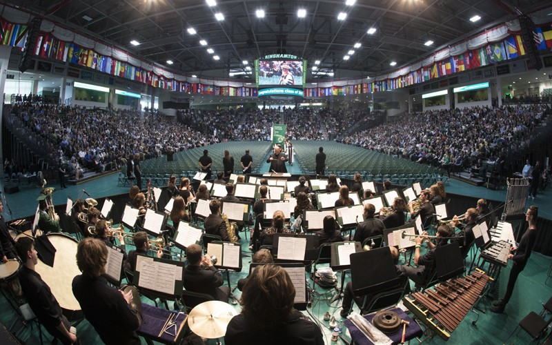 Daniel Fabricius conducts a group of Binghamton University student musicians during a Harpur College commencement ceremony in 2017.