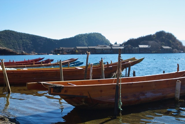 Boats outside a Mosuo community in China.