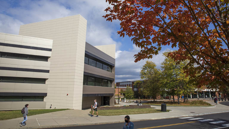 The refurbished Engineering Building surrounded by changing leaves in fall 2020.