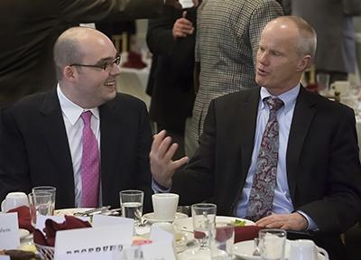 Justin Garcia and Binghamton University President Harvey Stenger speak before Garcia addressed the University Forum in February 2013.