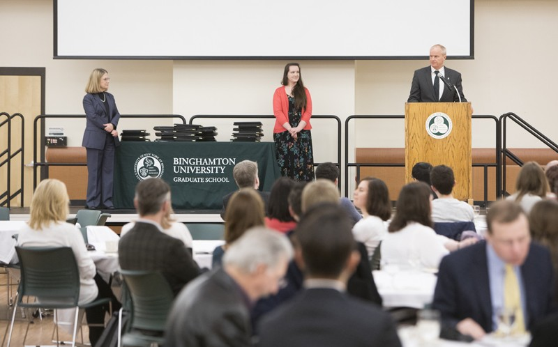 President Harvey Stenger salutes the recipients at the Graduate Excellence Awards ceremony on March 28.
