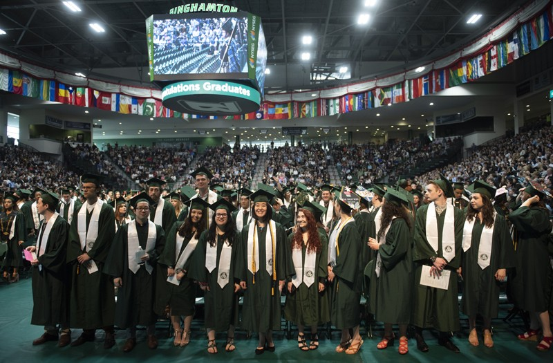 Harpur College students take part in the school's third Commencement ceremony at the Events Center on May 20.