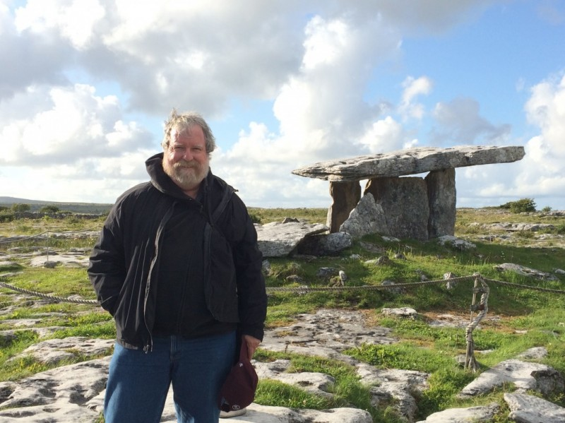 Anthropology Professor Thomas M. Wilson at a prehistoric dolmen monument in County Clare, Republic of Ireland.