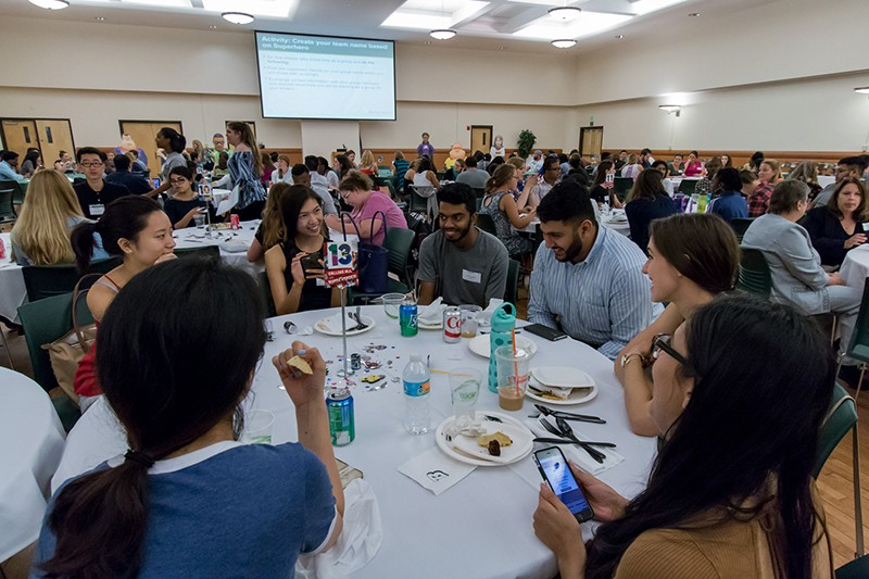 Pharmacy, nursing and social work students collaborate on their first interprofessional activity – selecting their superhero team name – during the Interprofessional Education kick-off dinner Monday, Aug. 21.
