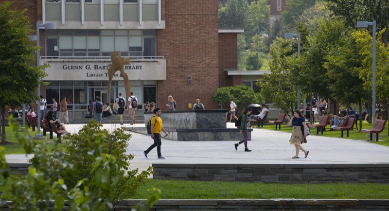 Students walk near the Library Tower on the first day of classes.