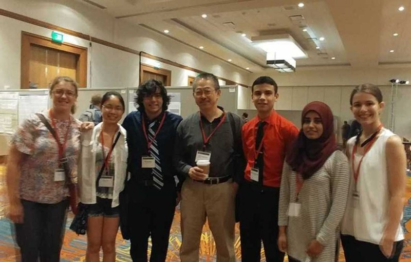 Vestal High School students (from left) Ewa Sulicz, Joyce Zhu, Evan George, Sheng-Liang Slogar, Kashaf Nadeem and Alexis Van Donsel presented a paper at a network science conference in June. They worked with Binghamton University professor Hiroki Sayama, center, throughout the 2016-17 academic year.