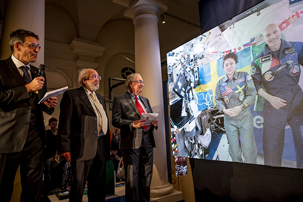 M. Stanley Whittinhgham waits with Didier Queioz and Michel Mayor (Nobel Prize winners in physics) to speak with International Space Station astronauts Luca Parmitano and Jessica Muir.