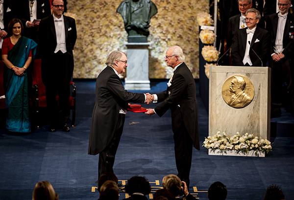 M. Stanley Whittingham receives his Nobel Prize in chemistry from King Carl XVI of Sweden.