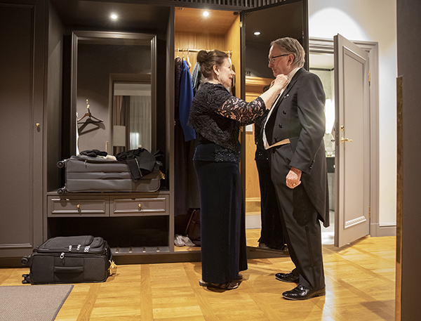 Georgina Whittingham helps her husband get ready for dinner with Sweden's royal family on Dec. 11, 2019.