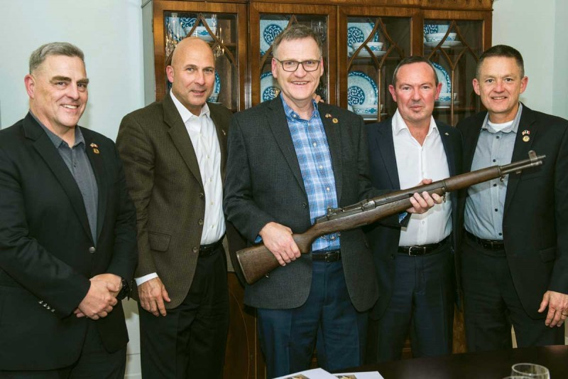 From left, U.S. Army Chief of Staff Gen. Mark A. Milley, Gen. Joe Anderson, Jim Farrell, French Army Chief of Staff Gen. Jean-Pierre Bosser and Vice Chief of Staff Gen. Daniel Allyn at a state dinner in Milley's quarters, where Martin Teahan's rifle was presented to Farrell by Bosser.