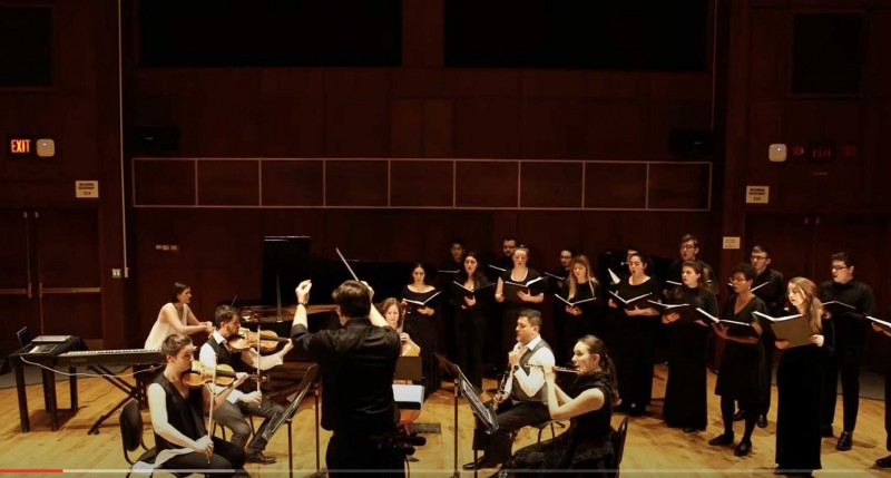 The Fifth House Ensemble and the Binghamton University Chamber Singers, directed by William Culverhouse, perform