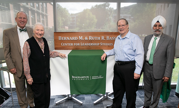Provost Don Nieman, Ruth Bass, Robert Bass and School of Management Dean Upinder Dhillon (left to right) unveil the sign for the newly named Bernard M. and Ruth R. Bass Center for Leadership Studies on Sept. 14, 2018.