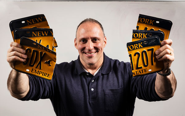 Bill Clark, an adjunct lecturer in the Health and Wellness Studies Department of the Decker School of Nursing, beat the Guinness World Record for tearing license plates.