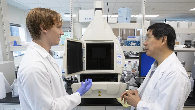 Student Ben Everhart works with Department of Biomedical Engineering chair Kaiming Ye at his laboratory in the Biotechnology Building at the Innovative Technologies Complex.