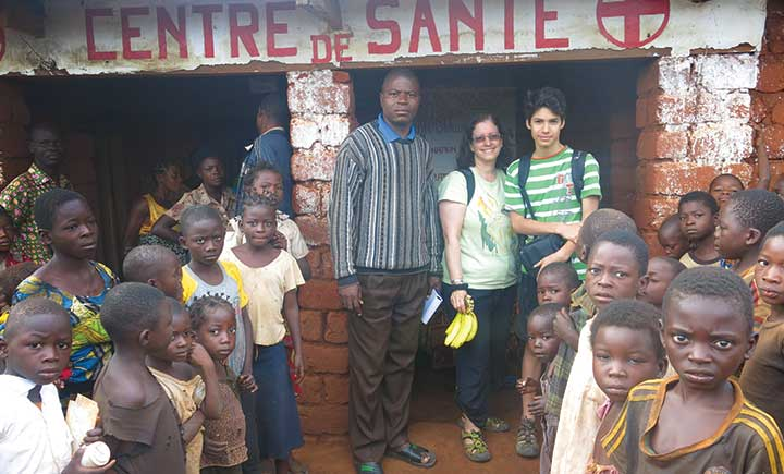 Annette Bongiovanni, center, works with her son Pace Bongiovanni, right, in the Democratic Republic of Congo. They were part of a large household and health facility survey conducted across four provinces of the DRC.
