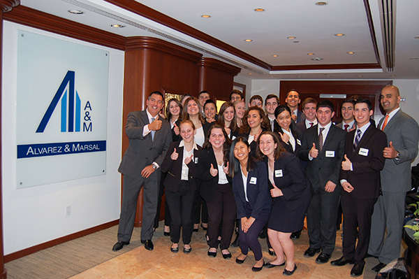 Paul Aversano '93 and Deep Parekh '01 hosted 24 School of Management students involved in the Dean's Mentoring Program at the New York City firm for an employer visit and case competition.