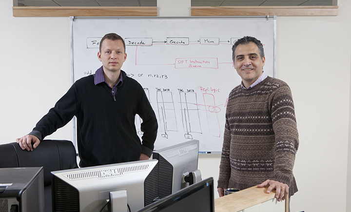 Binghamton University computer science professor Dmitry Ponomarev (left) with former Binghamton University computer science professor Nael Abu-Ghazaleh (right) who is now working at University of California, Riverside.