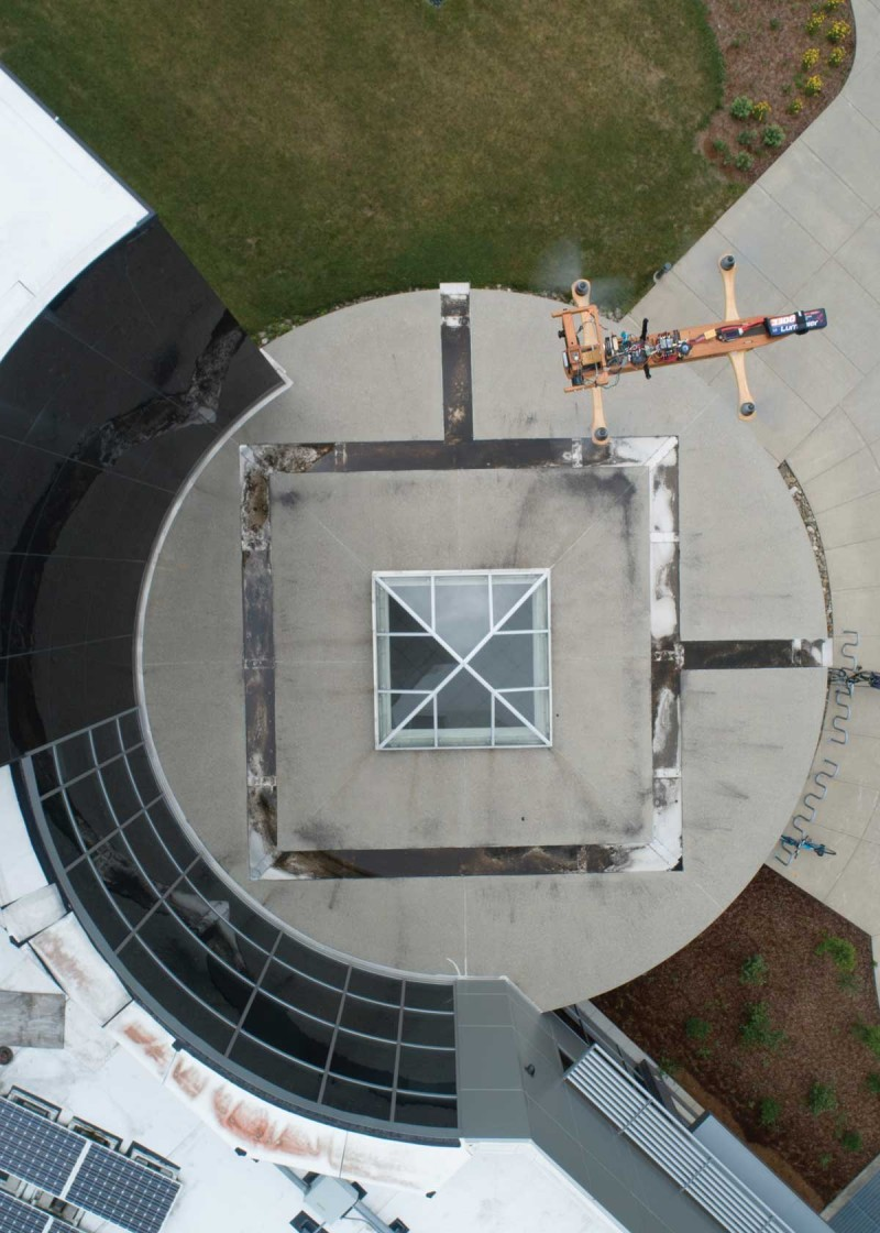 A drone flies above the rotunda at the entrance to the Engineering and Science Building.