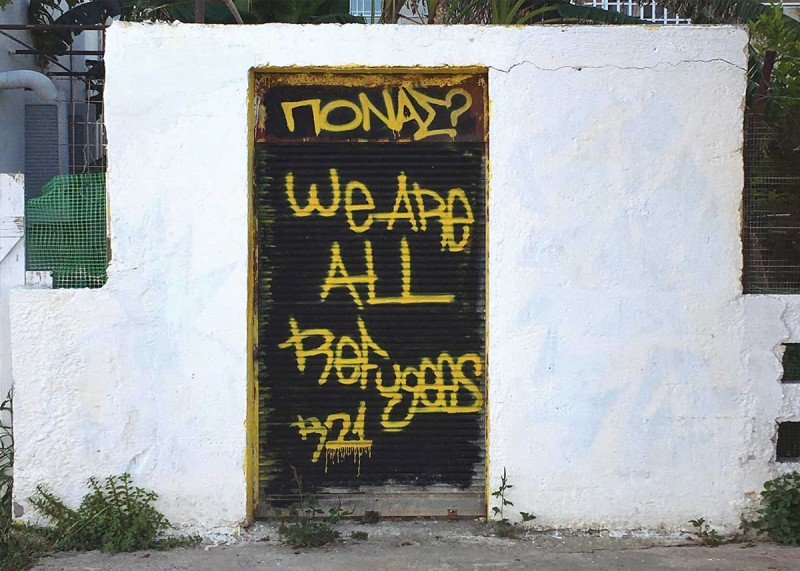 Graffiti on a door in Leros reads: We are all refugees.