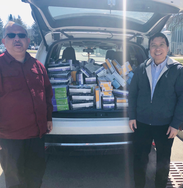 "Watson School Dean Krishaswami ""Hari"" Srihari, left, and Biomedical Engineering Chair Kaiming Ye deliver a donation of medical supplies to UHS."