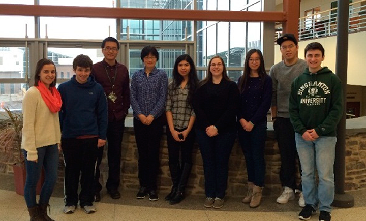 Associate professor Sha Jin with a group of students who worked on the study.