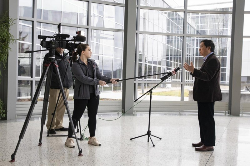 Professor Kaiming Ye, chair of the Department of Biomedical Engineering at the Watson School, talks with the media last month about  the ultraviolet sterilization stations that he and his team have developed to aid the fight against COVID-19.
