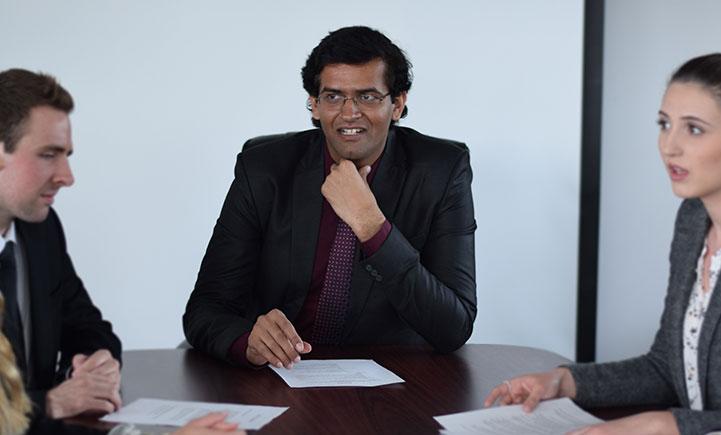 Karan Sharma, MBA '18 (center)