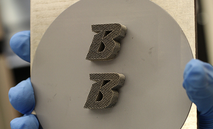 One way that the researchers tested their technique was by printing the Binghamton University logo onto silicon with the 3D metal laser printer.