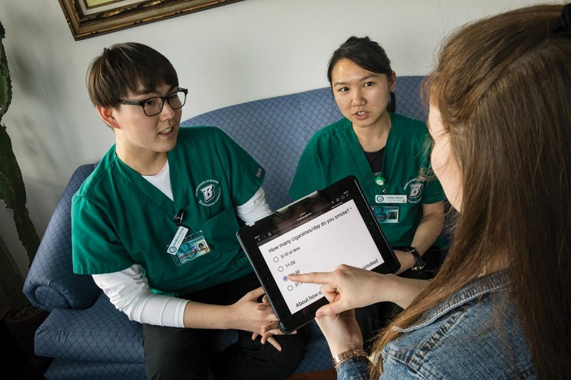 Nursing students Jae Moon Chung, left, and Lillian Ruan interview a mock patient as they prepare for the opening of a tobacco-use support clinic.