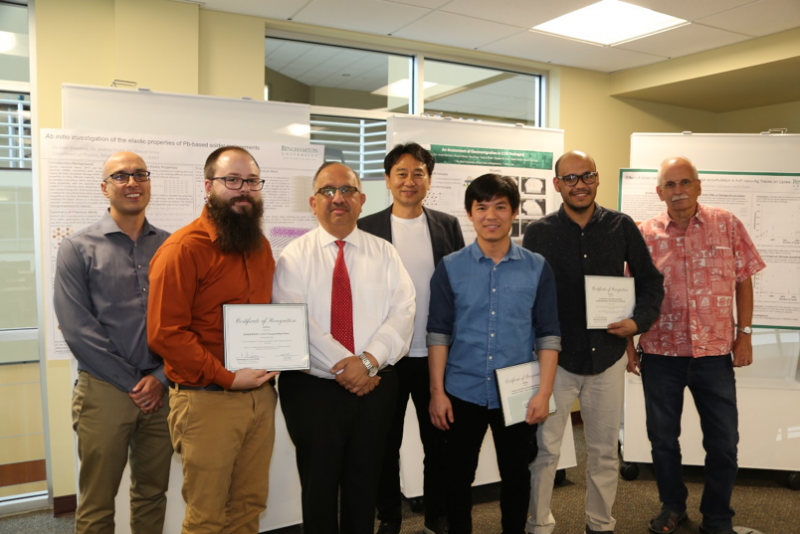 Winners of the poster competition at the recent Electronics Packaging Symposium – Small Systems Integration are, from left, Professor Manuel Smeu (faculty advisor for first place), Michael Woodcox (first place winner) Dean Krishnaswami